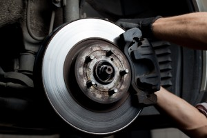 bigstock-Car-Mechanic-Repair-Brake-Pads-22862636